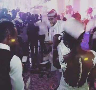 Known for his flamboyant and extravagant lifestyle, the entrepreneur lavishly sprayed the newly married couple using a money gun.  This is not the first time, the father of three will be pulling such. Two months ago, he was a guest at Mike Ezuruonye's sister's wedding and he also sprayed the newly married couple with a money gun.