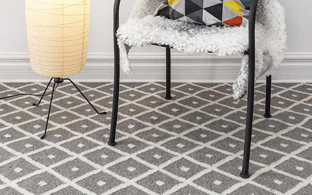 Gray patterned carpet is a neutral floor with a fun twist!