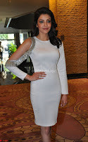 Beautiful Smiling Kajal Aggarwal in Creamy White Gown at MLA Telugu Movie Success Meet ~ .com Exclusive Pics 021.jpg