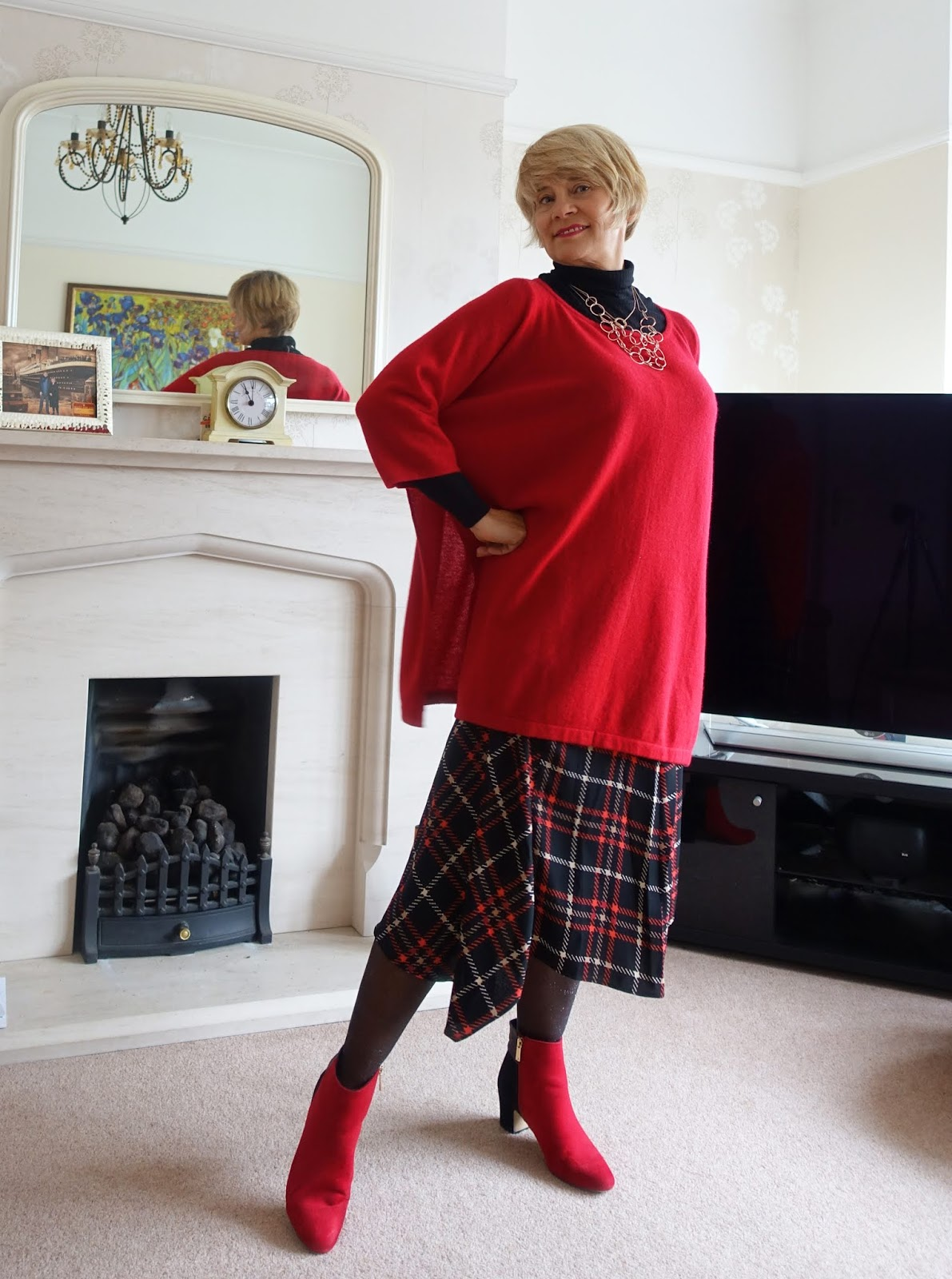A beautiful red cashmere poncho from Denner Cashmere London is perfect for so many situations: Autumn, when a coat isn't always needed; on planes and on business trips. They look great with jeans, joggers and smart business dress, as Is This Mutton? shows.