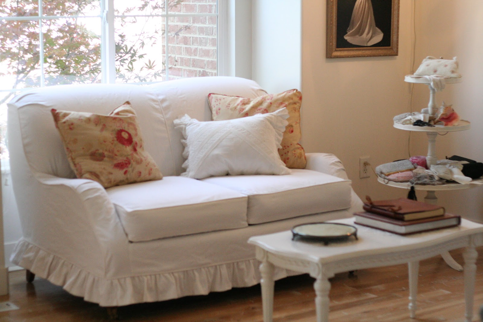 white denim loveseat with ruffled skirt