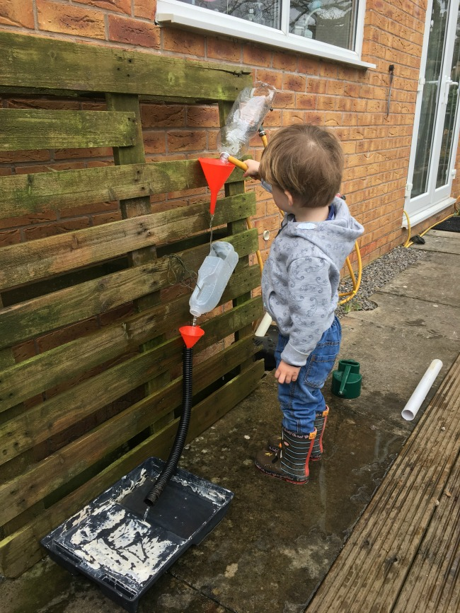 Our-weekly-journal-10-April-toddler-playing-with-water-wall