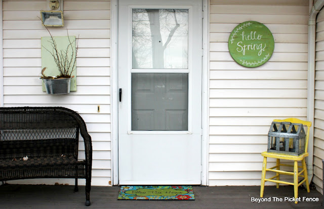 add a little spring decor and color to your porch