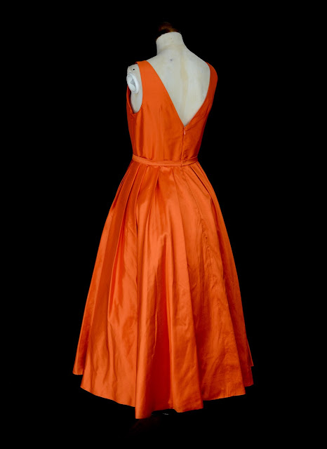 Orange silk dress by Alexandra King