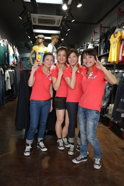 Four Chinese female shop workers