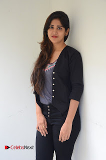Actress Chandini Chowdary Pictures in Black Jeans at Interview  0041.JPG