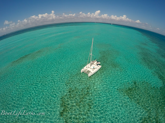 Sailing catamaran anchored off TIlloo Bank, Abacos, Bahamas