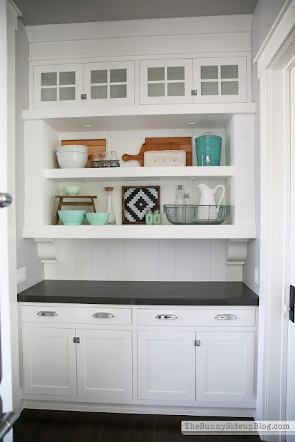 Bulter's hidden kitchen cabinets