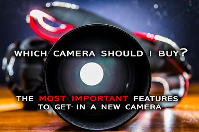 "an image showing a dslr camera with a glowing light shown through the lens with the title text overlaid on it ""which camera should I buy? a guide to the most important features to get in a new camera"""