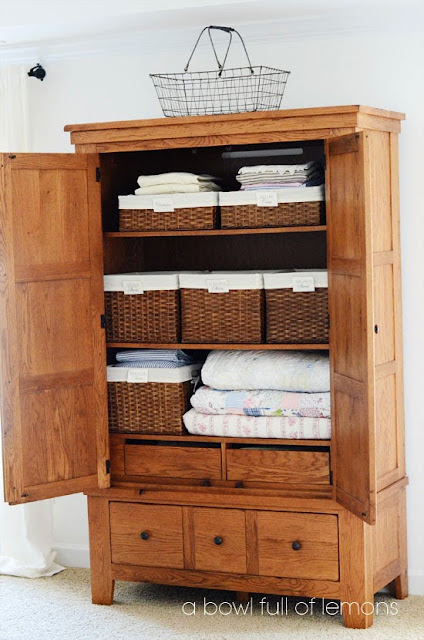 Use baskets for organizing an armoire into a closet:: OrganizingMadeFun.com