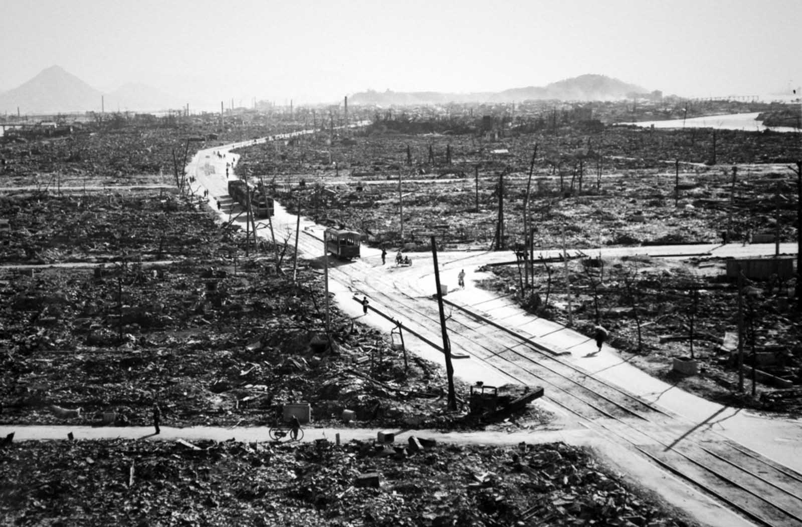 Streetcars, bicyclists, and pedestrians make their way through the wreckage of Hiroshima.