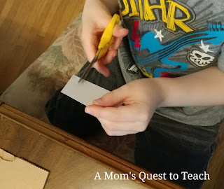 Cutting paper during children's craft