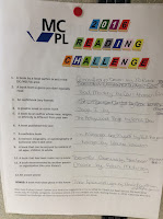 photo of reading challenge list with handwritten titles
