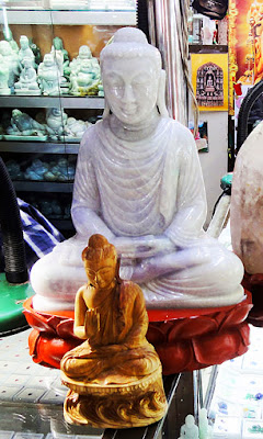 Beautiful white sitting Jade Buddha for sale