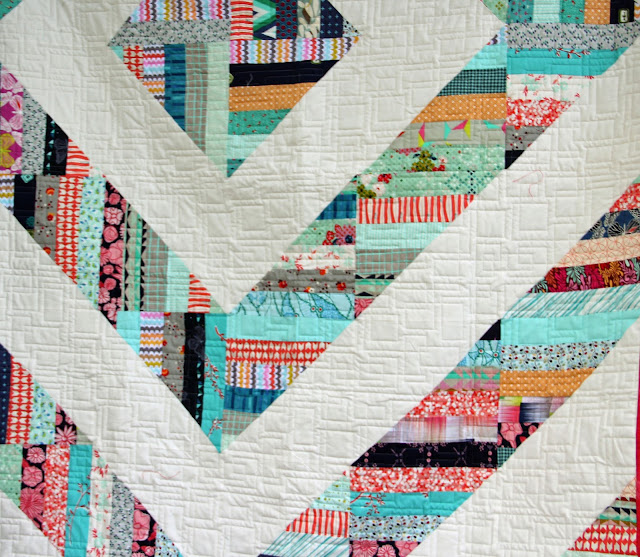 Two Modern Barn Raising quilts from Fons & Porter's Quilting Quickly