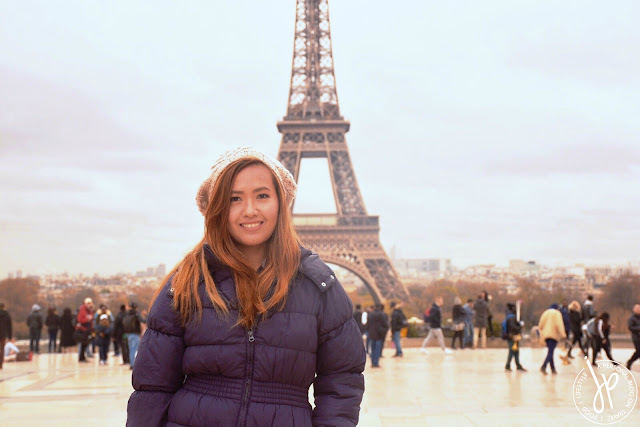 woman posing for photo with eiffel tower at the background