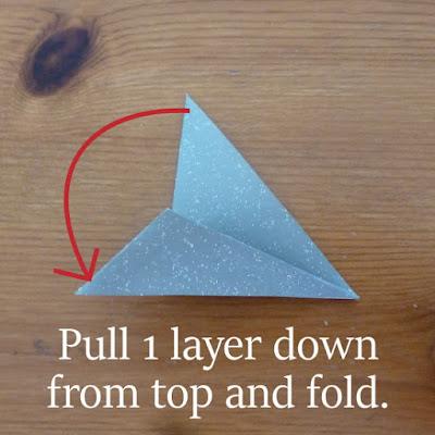 folding triangle into pointed arrow shape for star fold