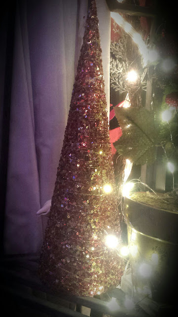 red and gold sequin Christmas tree decoration with led fairy lights