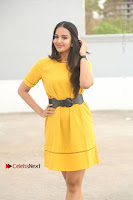Actress Poojitha Stills in Yellow Short Dress at Darshakudu Movie Teaser Launch .COM 0019.JPG