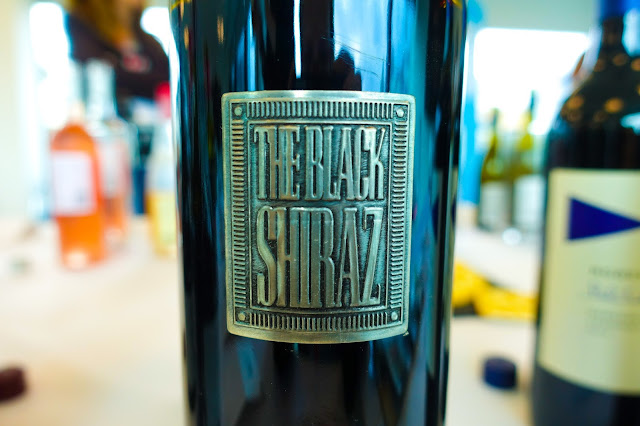 A close up of a metallic label saying The Black Shiraz from Berton Vineyards