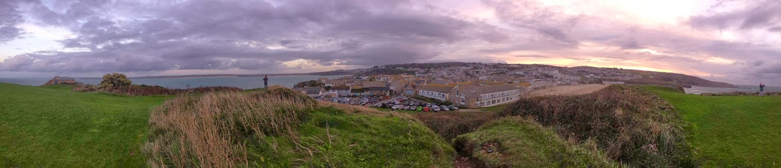 View of the whole of St. Ives from on top of the hill. The majority of the town can be seen along with one of the sandy beaches