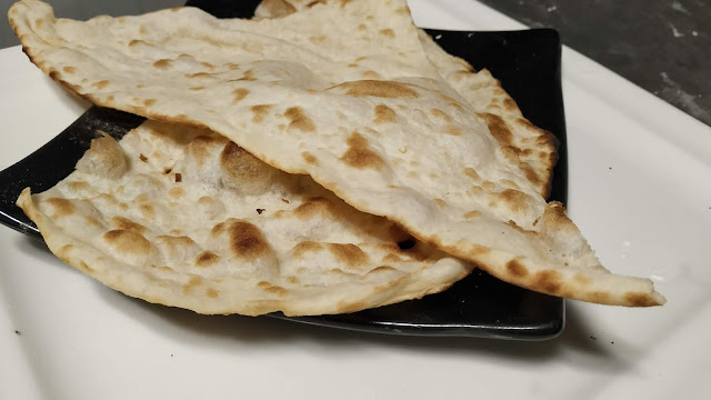 Two pieces of naan bread Food Recipe