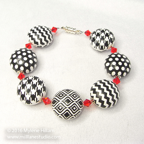 Black and white polkadots, houndstooth and chevrons combine to make a playful bracelet perfect for dressing up a T-shirt and jeans.