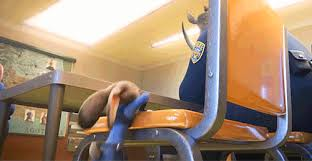 Judy climbs onto a chair in the police station