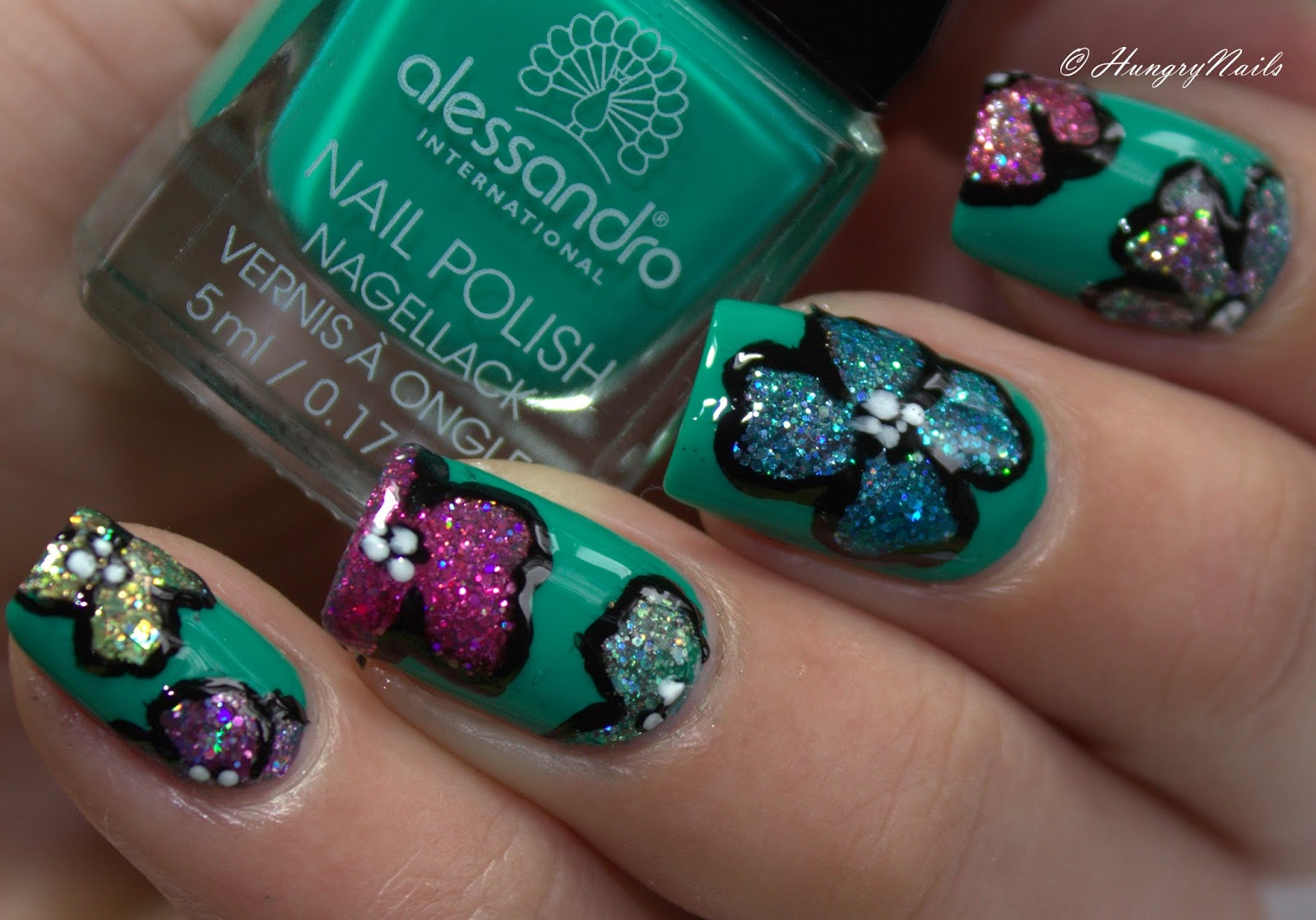 http://hungrynails.blogspot.com/2015/02/flower-glitter-naildesign.html