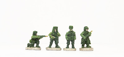 Kneeling, firing / Officers x 2 / Sentry in coat: