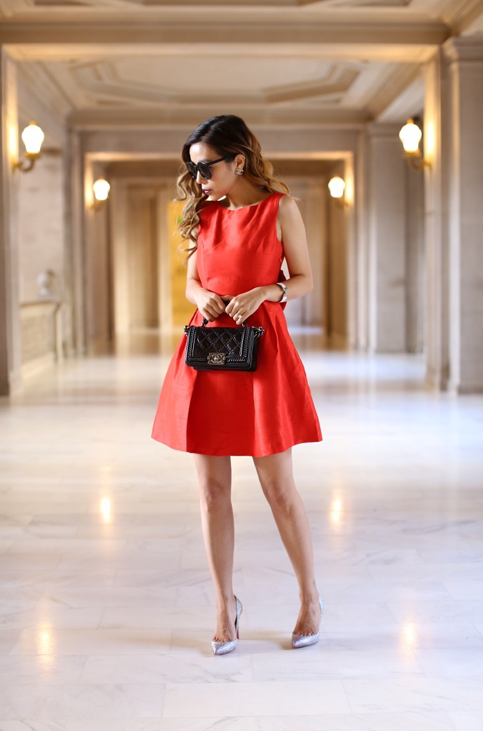 Soprano Bow Back Fit Flare Dress, Christian Louboutin glitter pumps, Chanel earrings, chanel boy bag, karen walker sunglasses, new years eve dress, bow dress, ring in the new year, new years eve outfit ideas