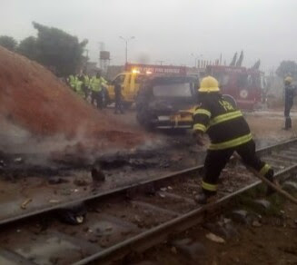 Two Men Sitting On Moving Train In Lagos; Fall, Die (Photos)