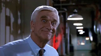 The Naked Gun 1988 movie still Leslie Nielsen