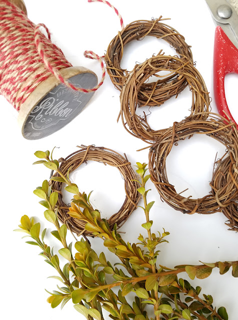 mini grapevine wreaths, baker's twine and boxwood clipping from the yard.