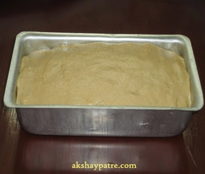 transfer the dough to loaf container - preparing wheat flour honey bread