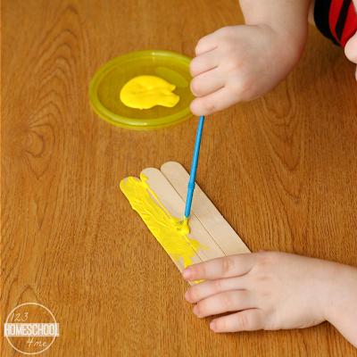 paint craft sticks yellow