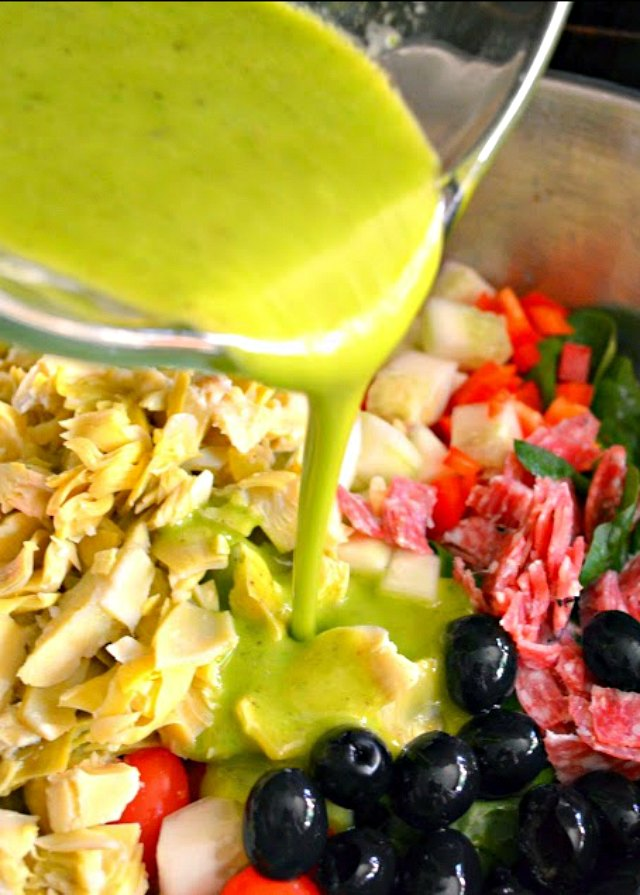 Italian Antipasto Pasta Salad With Basil Vinaigrette recipe is drizzle with dressing from Serena Bakes Simply From Scratch.