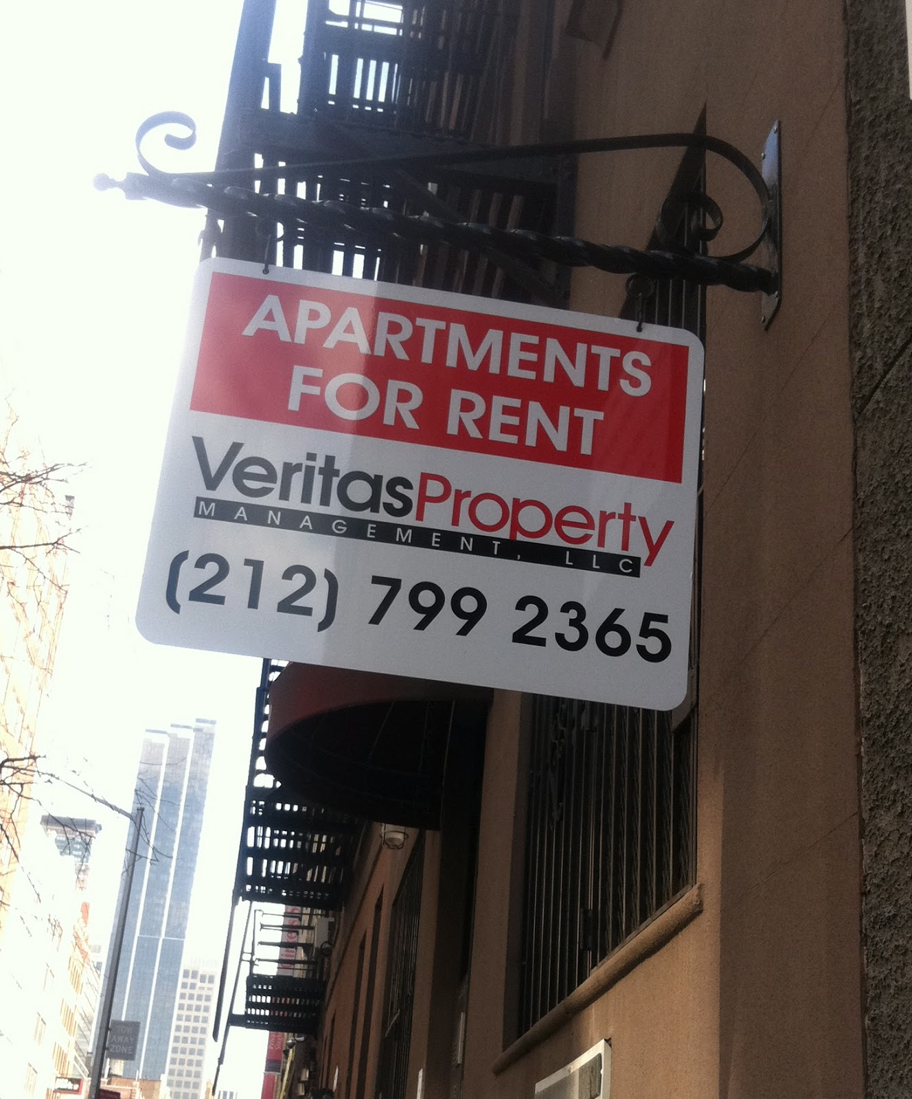 A For Rent Sign On Building