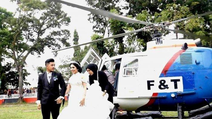 Pasangan pengantin di Pematangsiantar yang gunakan helikopter Polri.