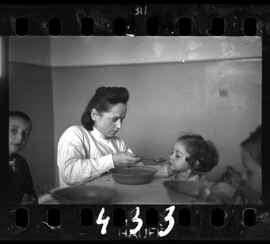 These 32 Pictures Had Been Buried For Years. The Reason Is Heart-Breaking - 1940-1944: A Nurse Feeding Children In An Orphanage