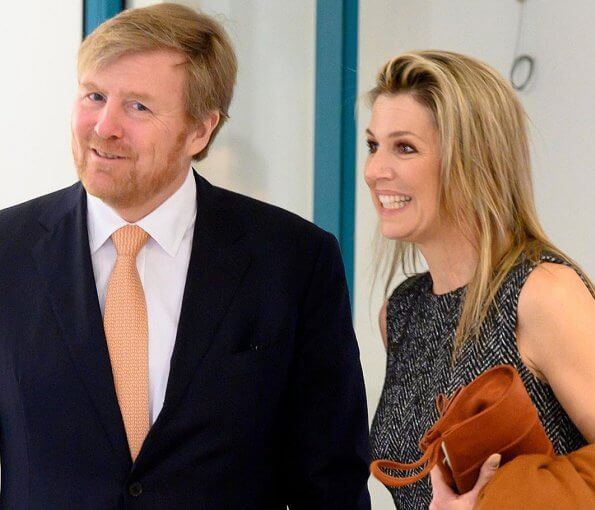 Queen Maxima wore Oscar De La Renta mixed check belted coat and Oscar De La Renta asymmetrical flannel tweed midi dress