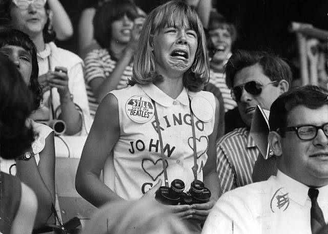 Young girl holding binoculars, sobbing at a Beatles concert. I still love the Beatles pin and Beatles and Hearts shirt. Pirate Radio and Sealand and Other stories of Rock, Radio, and Regulations. Marchmatron.com