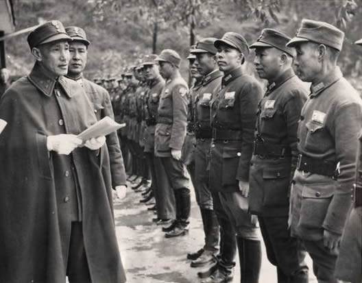 Chiang Kai-Shek inspecting Chinese troops at new infantry training center in Kwangsi Province