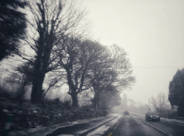 on the road, snowing