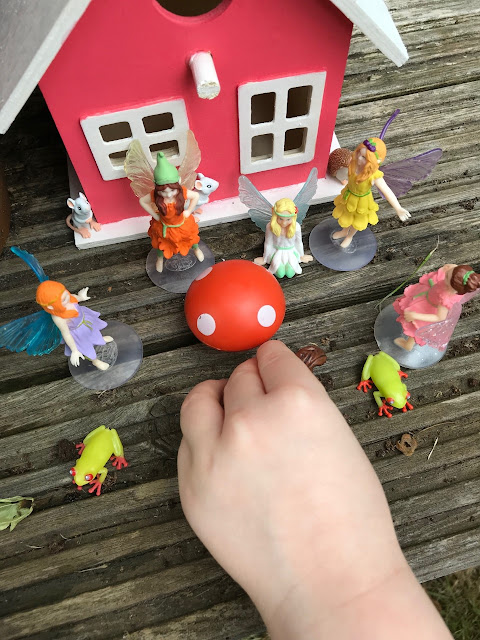 Childs hands playing with the animals and fairies