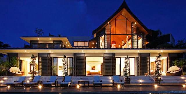 Photo of front facade and furniture by the pool of modern villa in Phuket