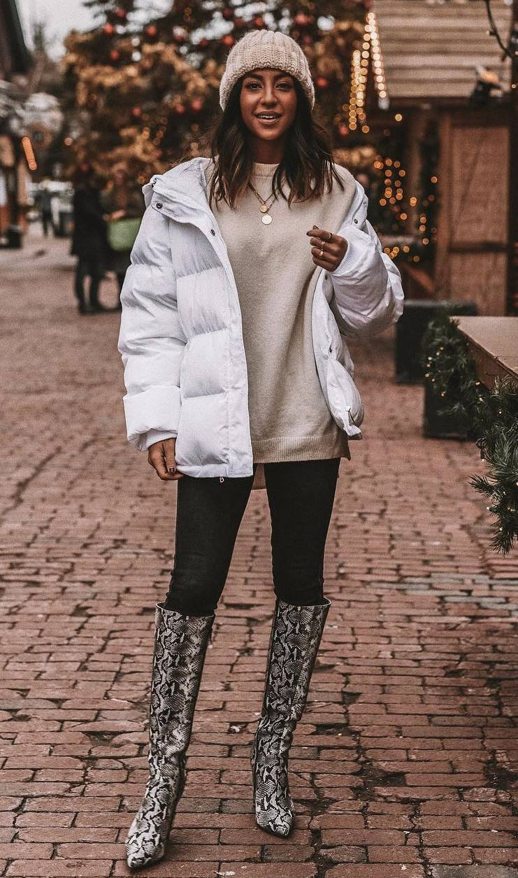 how to style a pair of snake boots : hat + black skinnies + sweater + white parka
