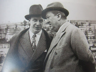 Ettore Bugatti (right) and his son Jean discuss race tactics