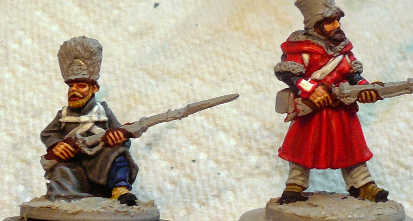 Figures prior to blacklining the white equipment straps.