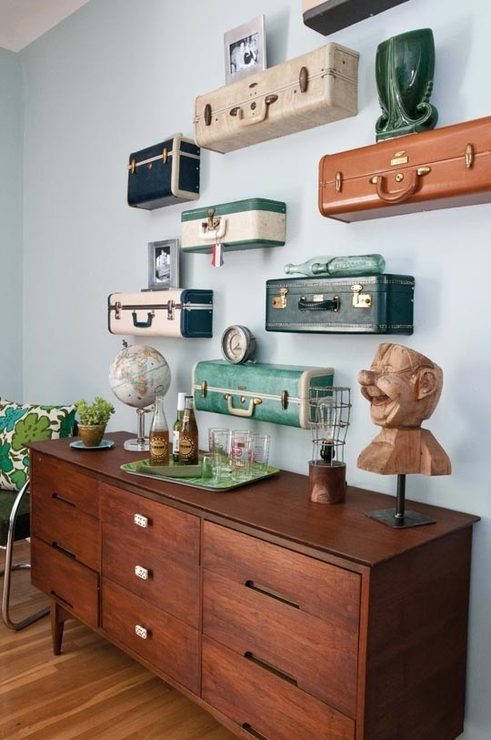 These vintage suitcase ends make for great shelves on the wall.